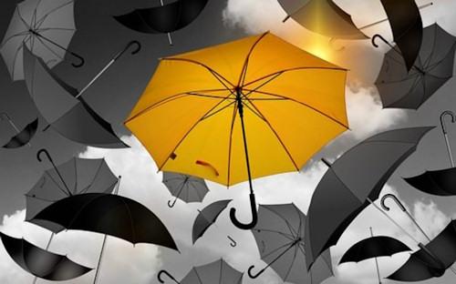 Fear vs Faith_yellow umbrella among a group of black ones